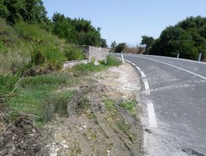 Roadside Spring, Sardinia, Italy: collection reservoir is too small, with overflow water damaging the road