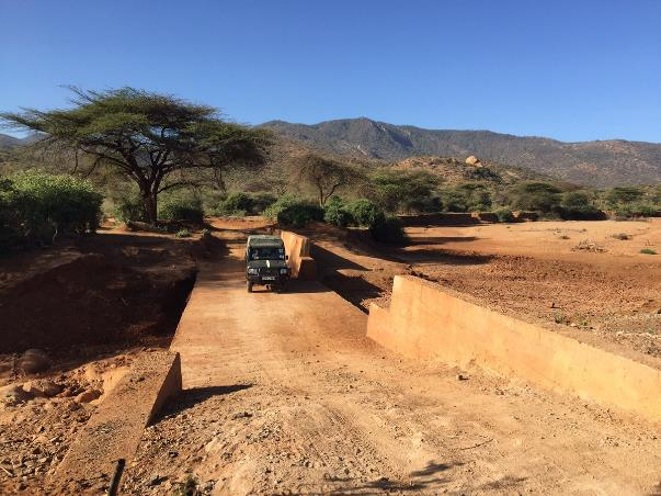Ethiopia: culvertless road drift combined with sand dam with scope to further raise sand deposition upstream by gradually closing the gap in the side wall