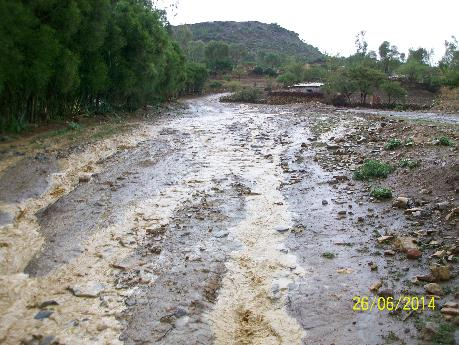 Ethiopia: water damage in action on an unpaved road; note the gully at the end of the slope