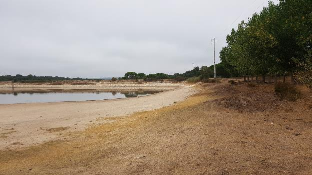 Road embankment acting as side of temporary storage reservoir for livestock (Portugal)