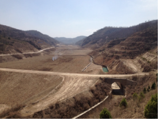 Road in combination with warping dam, making a degraded valley fertile with regularized drainage (Li 2016)