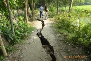 Seepage on rural road. Water seepage caused road collapse